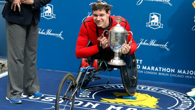 Romanchuk holds the trophy after winning the men's wheelchair race at the 123rd Boston Marathon in April 2019