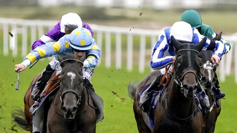 Dashing Roger (left), ridden by Harry Bentley, wins at Yarmouth