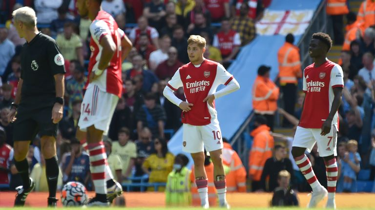 Arsenal's Emile Smith Rowe, and Bukayo Saka look dejected as the team struggles at Man City