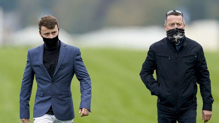 Cieren Fallon (left) walks the course at Ascot with his father Kieren