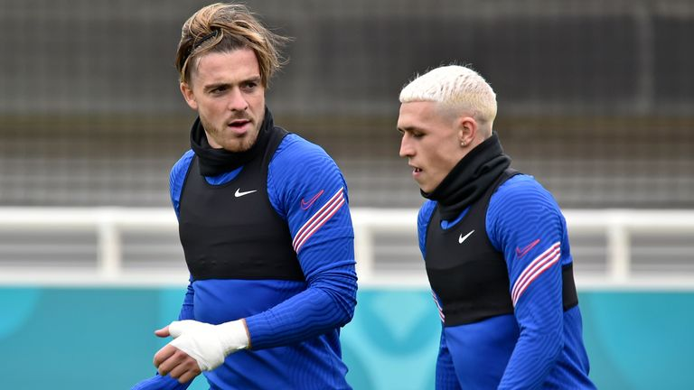 England's Jack Grealish, left, and Phil Foden during a training session at St George's Park, Burton upon Trent, England, Tuesday July 6, 2021, ahead of their Euro 2020 soccer championship semifinal match against Denmark in London on Wednesday. (AP Photo/Rui Vieira)
