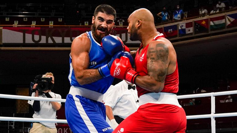 Britain's Frazer Clarke, right, punches Eliad Mourad, of France during a men...s super heavyweight over 91-kg boxing match at the 2020 Summer Olympics, Sunday, Aug. 1, 2021, in Tokyo, Japan. (AP Photo/Themba Hadebe, Pool)