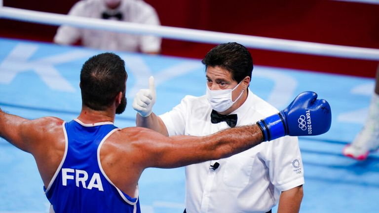 Eliad Mourad, of France reacts as he is disqualified by the referee during a men...s super heavyweight over 91-kg boxing match against Britain's Frazer Clarke at the 2020 Summer Olympics, Sunday, Aug. 1, 2021, in Tokyo, Japan. (AP Photo/Frank Franklin II)