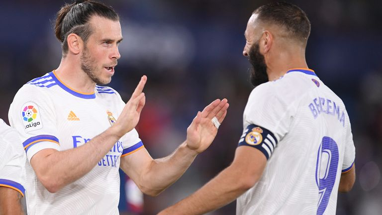 Gareth Bale celebrates with Karim Benzema after scoring