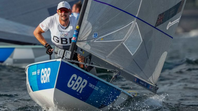 Giles Scott retained his men's Finn title shortly after Dylan Fletcher and Stuart Bithell clinched the men's 49er gold at Tokyo (Credit: BBC Sport)