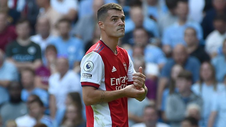 Granit Xhaka leaves the pitch after being sent off (AP)