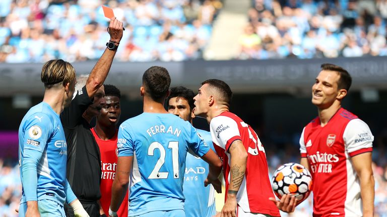 Granit Xhaka is shown a red card by referee Martin Atkinson