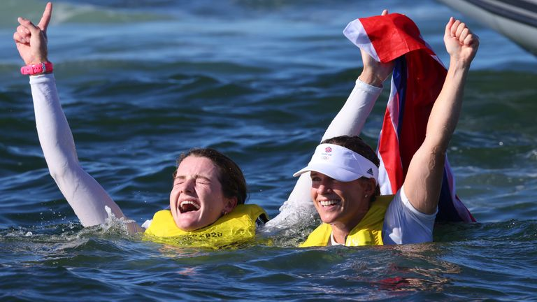 Mills and McIntyre react after winning the women's 470 gold medal at Enoshima Harbour