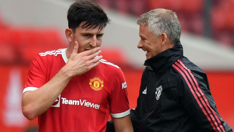 Harry Maguire and Ole Gunnar Solskjaer