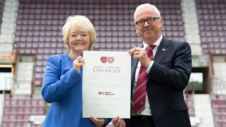 Chair of Heart of Midlothian, Ann Budge, and Chairman of the Foundation of Hearts, Stuart Wallace are pictured with the Heart and Soul Day certificate as Heart of Midlothian officially become the biggest fan-owned club in British football