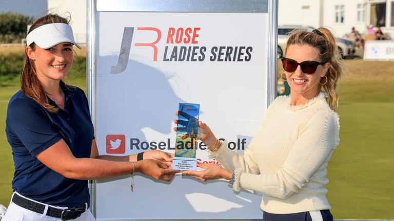 Jae Bowers (left) presented with the trophy by Kate Rose (right) after winning the Rose Ladies Series event at Royal Birkdale