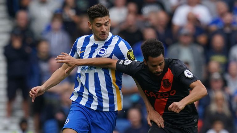 Jakub Moder and Andros Townsend battle for the ball