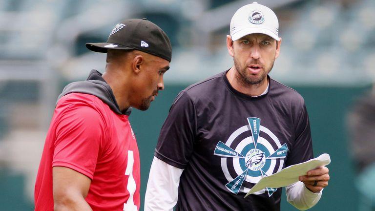 Eagles quarterback Jalen Hurts gets some feedback from offensive coordinator Shane Steichen during practice