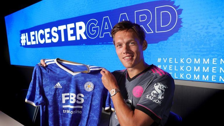 Jannik Vestergaard poses after signing for Leicester City