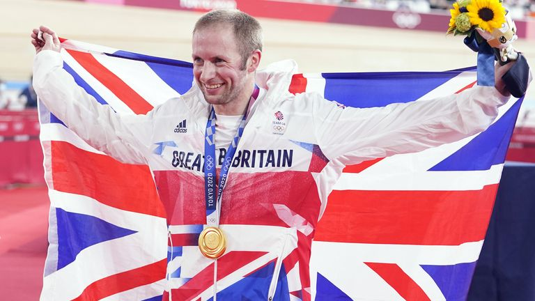 Great Britain's Jason Kenny celebrates with the gold medal in the men's keirin final to become the most decorated British Olympian of all time