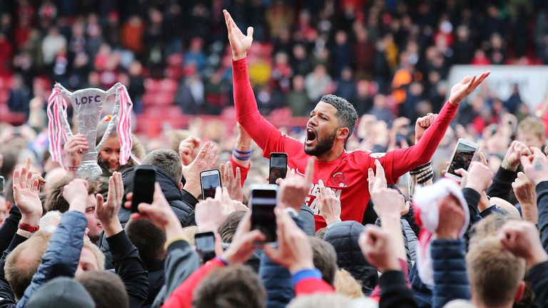 Jobi McAnuff celebrates as Leyton Orient are promoted back to the Football League as champions of the National League in 2019