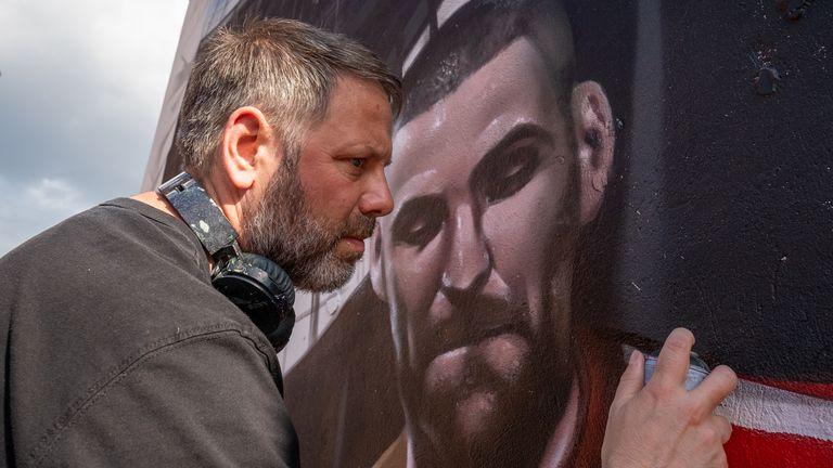 Jody Thomas works on the Sky HDR art mural on Tottenham High Road