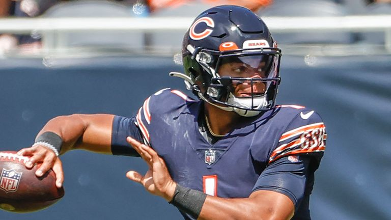 Bears quarterback Justin Fields looks to pass during the first half against the Dolphins (AP Photo/Kamil Krzaczynski)
