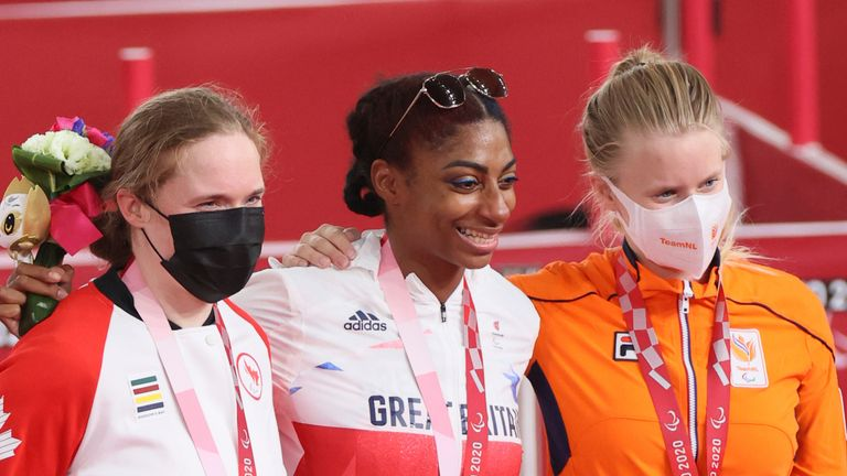 Kadeena Cox retained her Paralympic title in style by setting a new world record