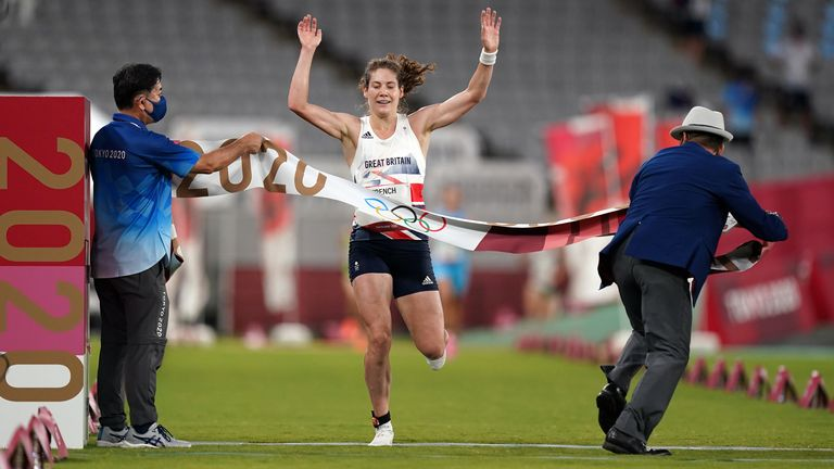 Kate French crossing the line and realising that an Olympic gold medal belongs to her