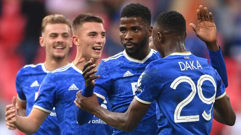 Leicester players celebrate with Kelechi Iheanacho after his late penalty won the Community Shield