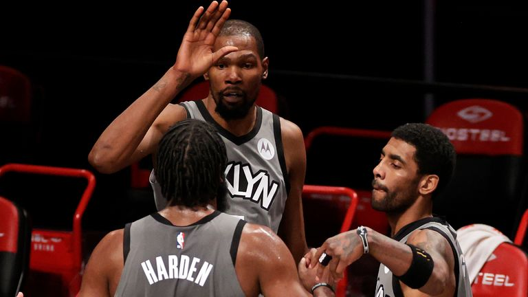 Kevin Durant (centre), Kyrie Irving (right) and James Harden are looking to bring a championship to Brooklyn (AP)