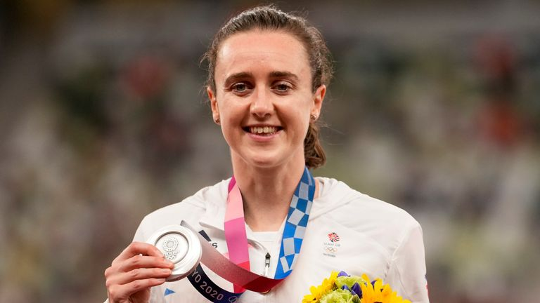 Silver medalist Laura Muir poses during her medal ceremony.  (AP Photo/Martin Meissner)