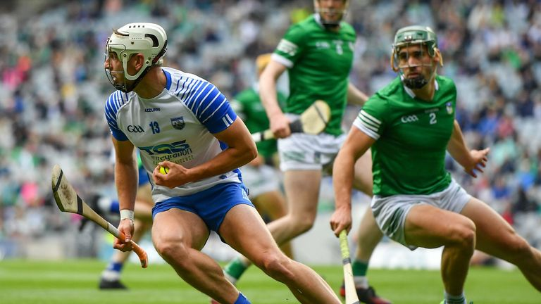 Dessie Hutchinson of Waterford in action against Sean Finn of Limerick