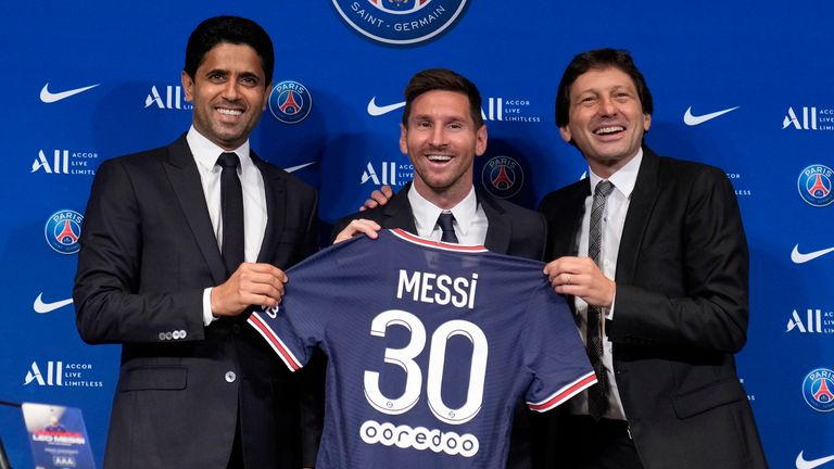 Lionel Messi poses for a photo with PSG president Nasser Al-Khelaifi and sporting director Leonardo (AP)