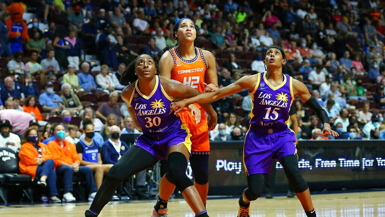 Los Angeles Sparks forward Nneka Ogwumike (30) and Los Angeles Sparks guard Brittney Sykes (15) box out Connecticut Sun forward Brionna Jones (42) during a WNBA game between Los Angeles Sparks and Connecticut Sun on August 26, 2021, at Mohegan Sun Arena in Uncasville, CT. (Photo by M. Anthony Nesmith/Icon Sportswire) (Icon Sportswire via AP Images)