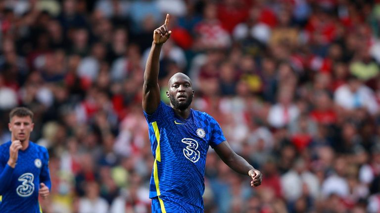 Chelsea's Romelu Lukaku celebrates after scoring his side's opening goal during the English Premier League soccer match between Arsenal and Chelsea at the Emirates stadium in London, England, Sunday, Aug. 22, 2021.