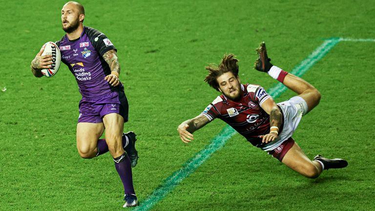 Leed winger Luke Briscoe evades the tackle of Wigan's Joe Shorrocks