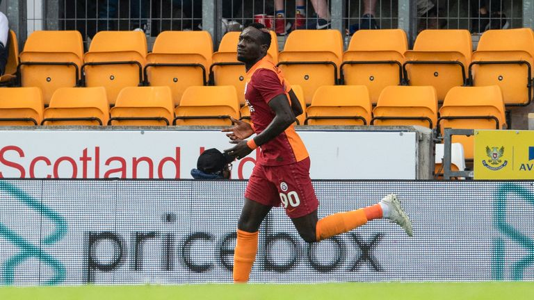 Mbaye Diagne wheels away after handing Galatasaray the lead at McDiarmid Park