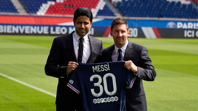 Lionel Messi, right, and PSG president Nasser Al-Al-Khelaifi hold Messi's jersey Wednesday, Aug. 11, 2021 at the Parc des Princes stadium in Paris.