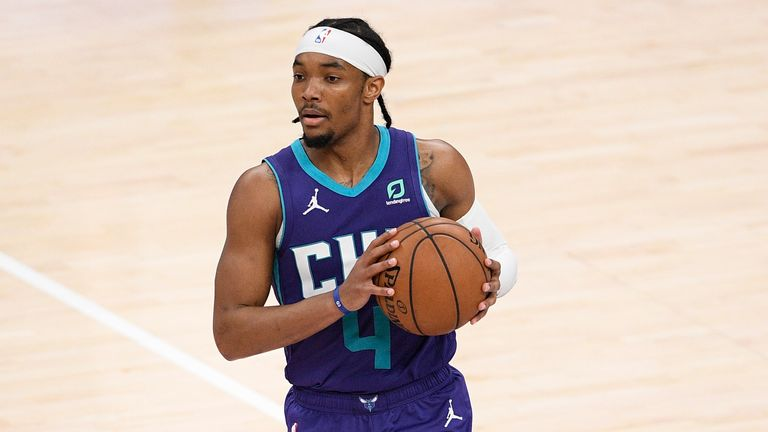 Charlotte Hornets guard Devonte' Graham (4) in action during the second half of an NBA basketball game against the Washington Wizards, Sunday, May 16, 2021, in Washington. (AP Photo/Nick Wass).