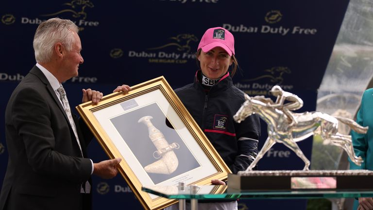 Nicola Currie is presented with the ride of the day award at the Shergar Cup