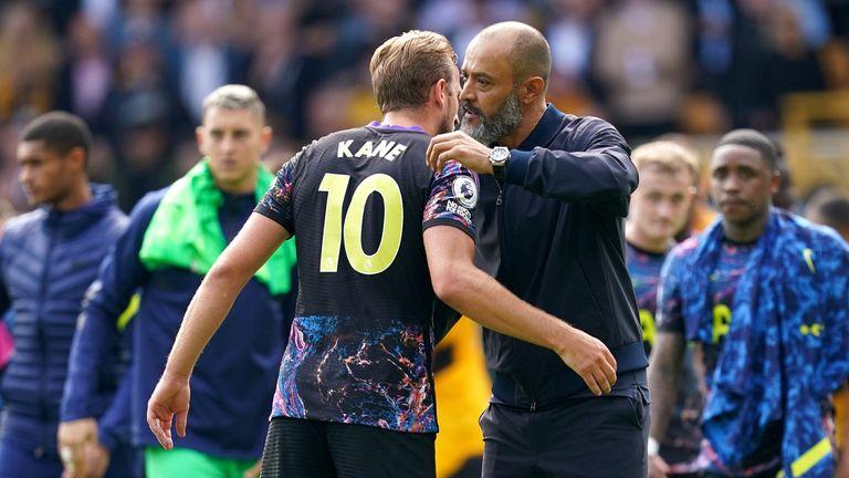 Tottenham Hotspur's Harry Kane (left) hugs manager Nuno Espirito Santo at the end of the Premier League match at the Molineux Stadium, Wolverhampton