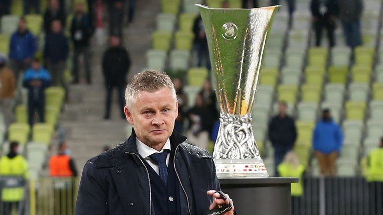 Ole Gunnar Solskjaer walks past the Europa League trophy after Manchester United's defeat on penalties to Villarreal in Gdansk in May