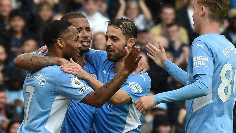 Raheem Sterling, scorer of Man City's fourth goal, celebrates with team-mates (AP)