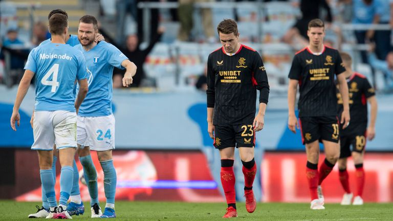 Rangers' Scott Wright looks dejected as Malmo players celebrate their opening goal