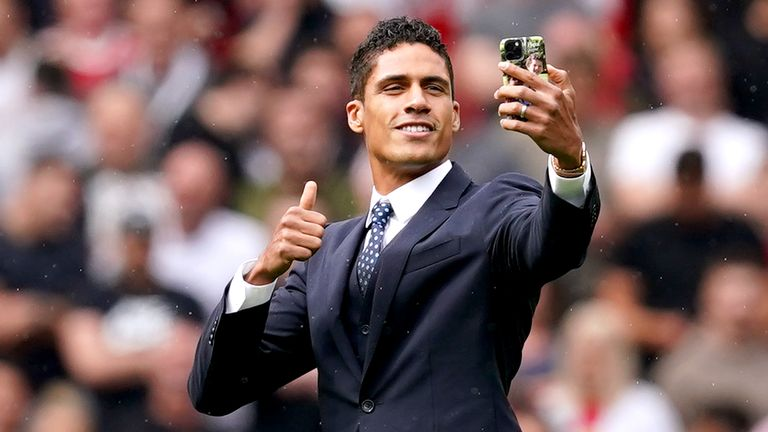Raphael Varane takes a selfie on the pitch at Old Trafford