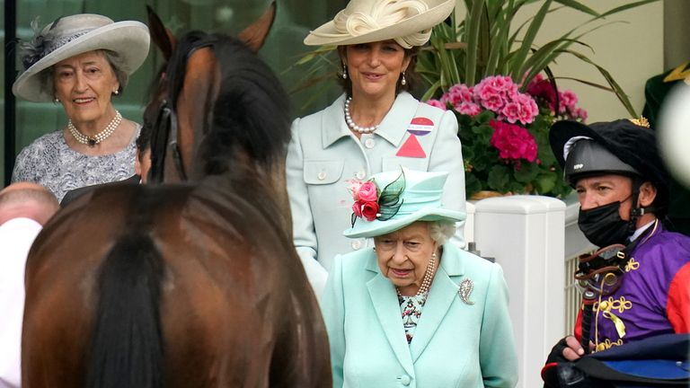 Her Majesty The Queen and Frankie Dettori in the parade ring at Royal Ascot with Reach For The Moon