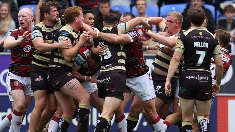 A 15th minute brawl on the pitch saw Wigan's Brad Singleton and Leigh's Jack Ashworth both red carded