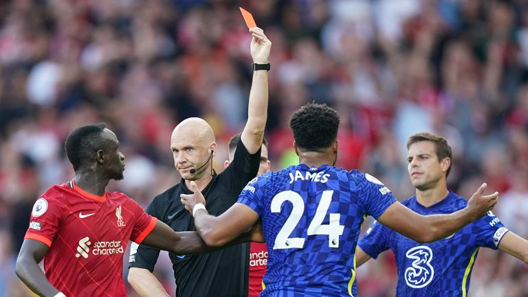 Reece James is shown a red card by referee Anthony Taylor