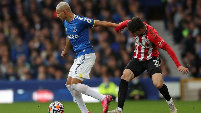 Richarlison (L) and Southampton's Tino Livramento battle for the ball