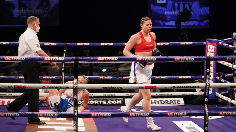 *** FREE FOR EDITORIAL USE ***.Savannah Marshall vs Maria Lindberg, WBO World Female Middleweight title Fight..10 April 2021.Picture By Dave Thompson Matchroom Boxing.Savannah Marshall walks away after knocking down her opponent for the second and final time.