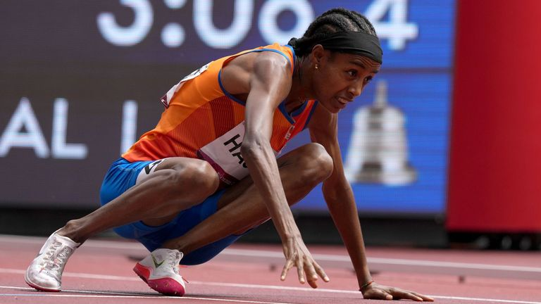 Netherlands' Sifan Hassan recovers after a fall during the Women's 1500m Heats in Tokyo