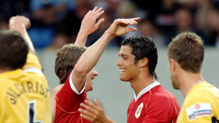 Manchester United's Ole Gunnar Solskjaer (C) celebrates his goal against Oxford, with team-mate Cristiano Ronaldo (second right) during the friendly match at the Kassam Stadium, Oxford.
