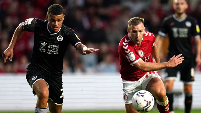 Joel Latibeaudiere and Andreas Weimann battle for the ball