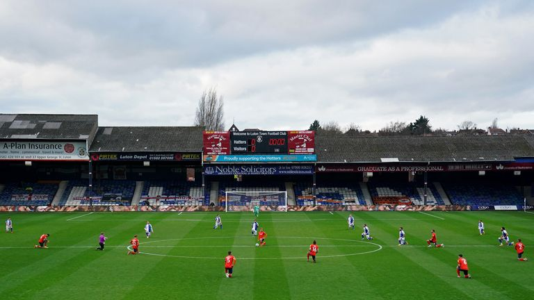 A general view of players taking a knee before the Sky Bet Championship match at Kenilworth Road, Luton between Luton Town and Blackburn Rovers in November 2020